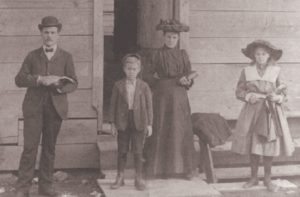 J.W. and Mattie Buckalew with their children, Grace and Colie